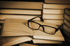 Glasses on open book.