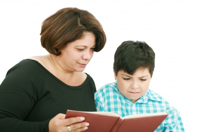 Mother And Son Reading A Book . Image courtesy of  / FreeDigitalPhotos.net