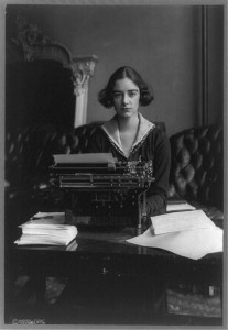 Flora Payne Whitney Miller, three-quarter length portrait, seated at typewriter, facing front. Library of Congress. : LC-USZ62-97743
