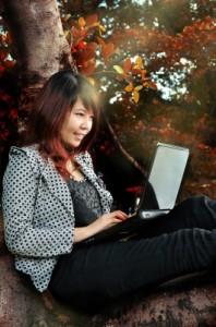 Woman Playing Laptop by Just2shutter/Courtesy of www.freedigitalphotos.net