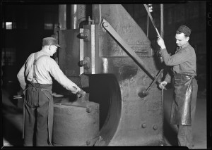 Railroad parts. Baldwin Locomotive Works. Blacksmith and helper forging and hammering tools, March 1937. National Archives and Records Administration. Flickr the Commons.